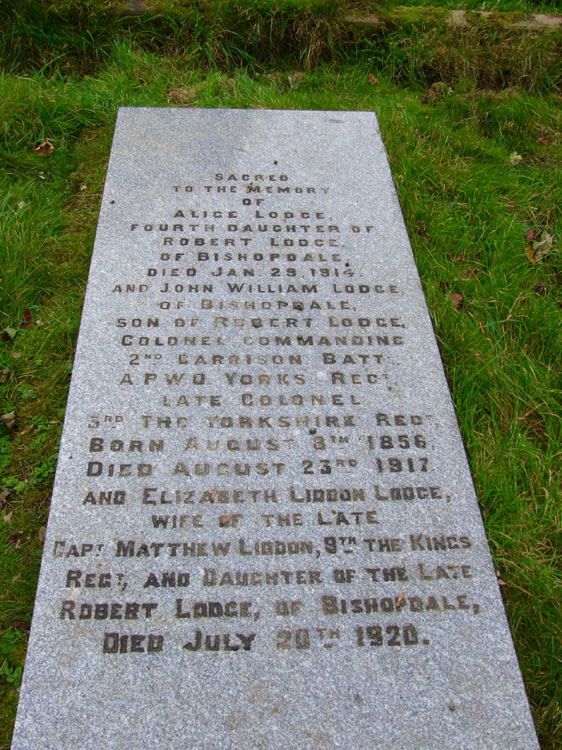 detailed photo of the left-hand headstone, - includes Colonel Lodge's commemoration, is below.