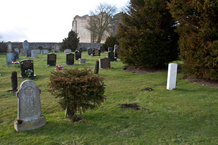 Private Vickers' headstone (white) in the cemetery, with Bowes Castle seen in the background.