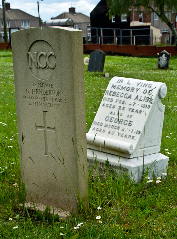 The grave of Private G Henderson of the Non Combatant Corps, in front of the family headstone.