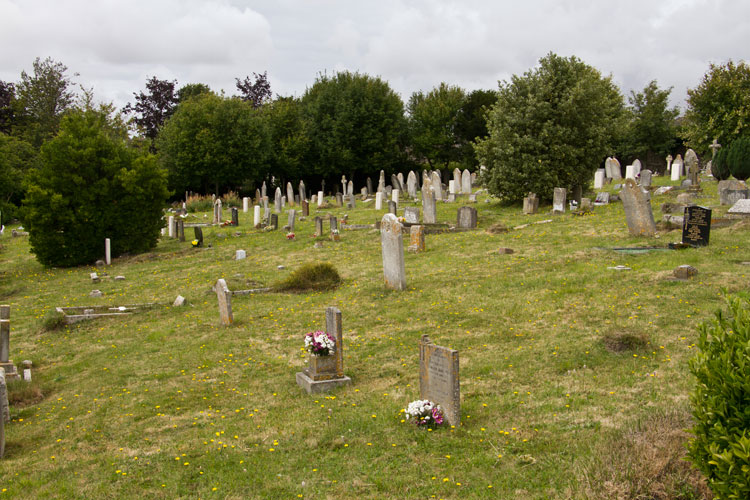 Dorchester (Fordington) Cemetery. Private Hand's grave is on the left, beside the bush.