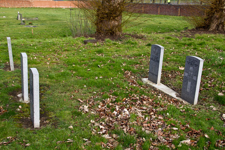 The headstones of Private Kelly (198H) on the right and Private Lockey (199H) beside it. Private Leahy's grave is unmarked in ploy 201H.