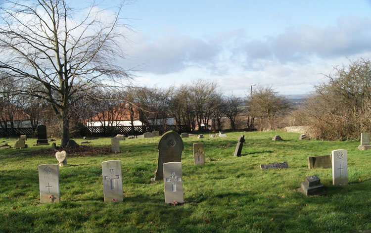 Penshaw (All Saints') Churchyard, with the graves of Privates Oliver and Walker in the centre.