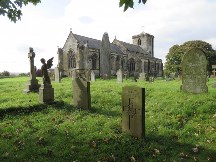 Rudston (All Saints') Churchyard and L/Cpl Etherington's Headstone (also in view is the Rudston Monolith)