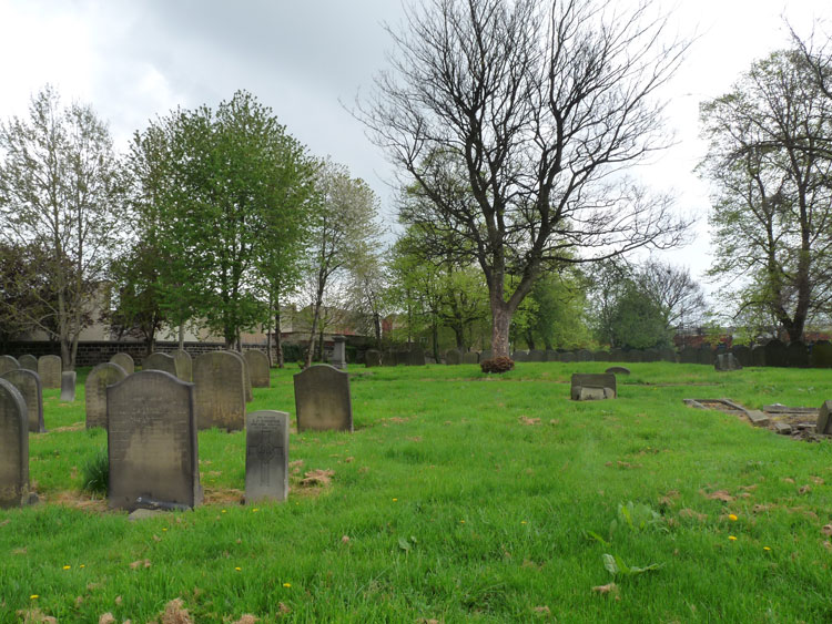 Leeds (Beckett Street) Cemetery, with the headstone for Private Thompson in the centre foreground