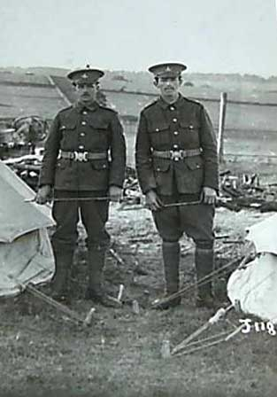 Two soldiers of the Yorkshire Regiment standing between two tents. James is on the left (small 'x' over his head).