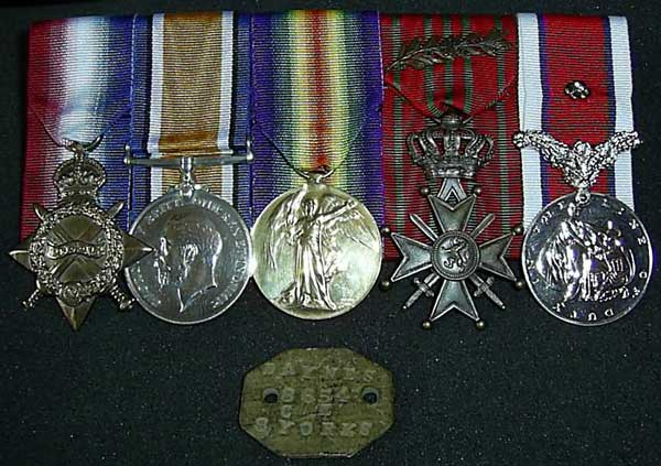 James Daynes medals and identification tag. From the left, the 1914-15 Star, the British War Medal, the Victory Medal and two other medals which are currently not identified.