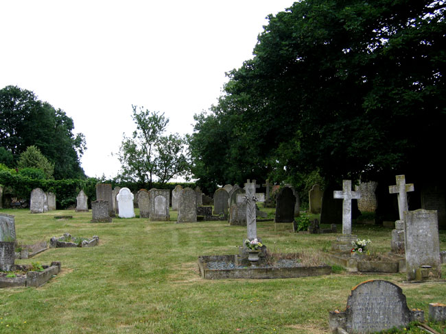 Morcott Churchyard, - Edmund Joyce's grave is the white headstone towards the rear.