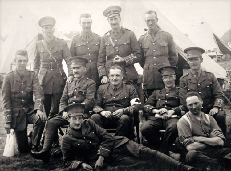 William Whitesmith Constantine, in camp, date unknown (seated far right)>