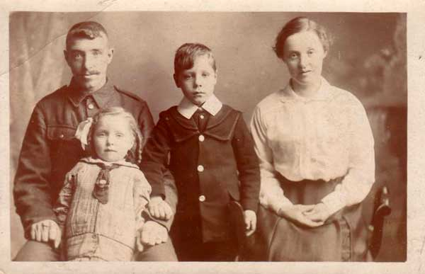 James Stansfield with his wife, Emma, and two children.