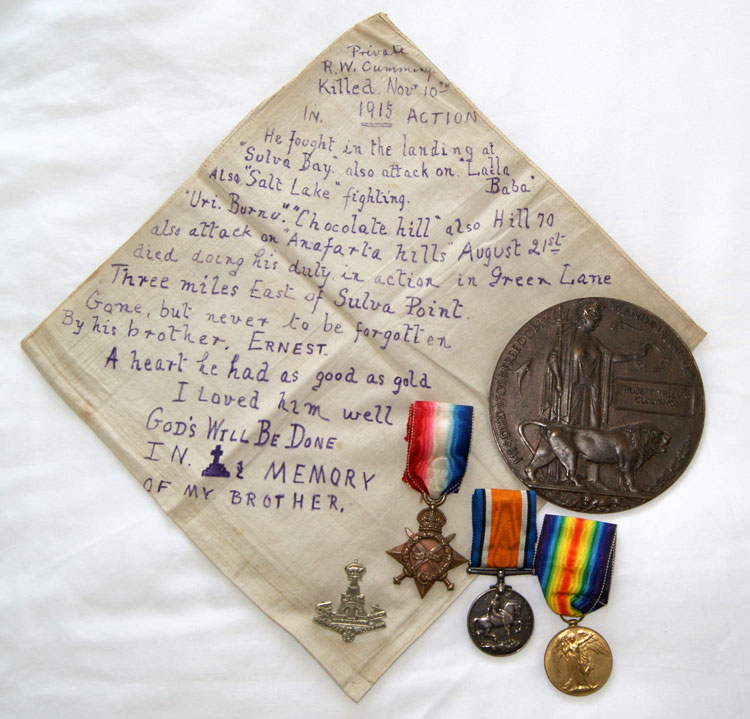 The Handkerchief with a Message Written by Ernest Cummings, together with Robert William Cummings' Medals and Memorial Plaque