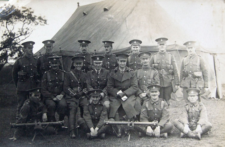 William Stockdale, - 3rd from right in the back row, with a group of soldiers from the Yorkshire Regiment, West Yorkshire Regiment, and Grenadiers. The two instruments in the foreground are range finders. Clearly, this group of men will have been on a course in using range finders.