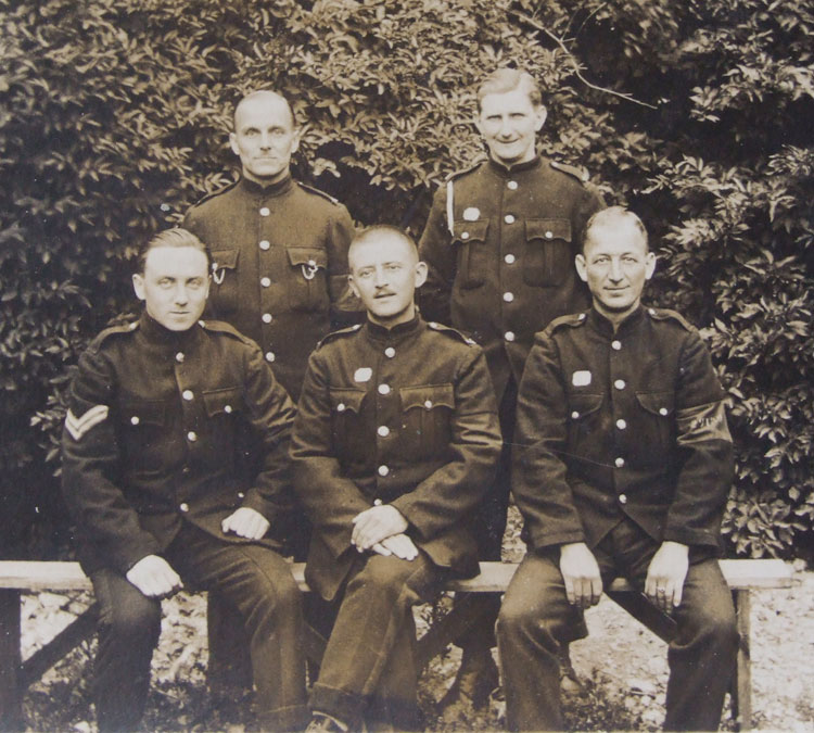 William Stockdale, back row (right), with a fellow group of Prisoners of War. These are identified from the card below as Private F Mitchell, Private W H Stockdale, Corporal J H Vasey, Private E Frain, and Private J Perkins.